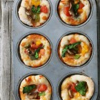Mini pizzas made in a muffin tin, from Cheap Recipe Blog