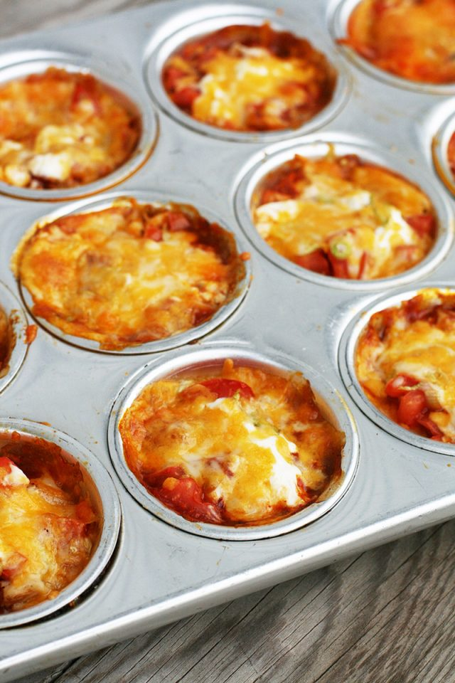 Mini enchilada stacks: Tortilla shells, cheese, enchilada sauce, and other ingredients make these delicious bites.