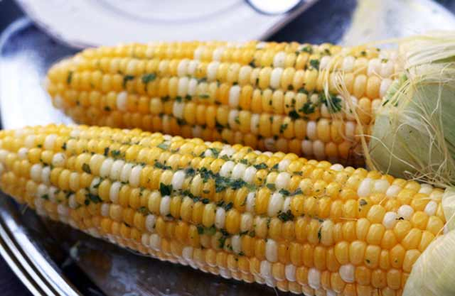 Sweet corn with herb butter, from Cheap Recipe Blog.