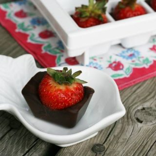 Chocolate-covered strawberries made in an ice cube tray. The easiest way to make chocolate-covered strawberries! Click through for easy recipe.
