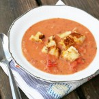 Creamy garlic tomato soup with grilled cheese croutons. The best combo ever, in one delicious dish.