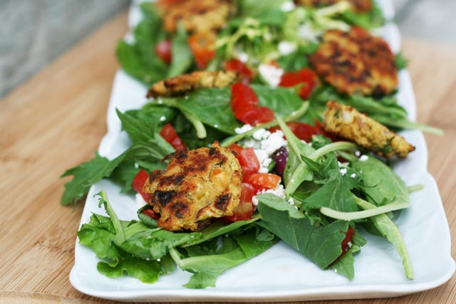 Falafel salad: Falafel become a meal when you add greens, veggies, Feta and dressing. Click through for entire recipe.