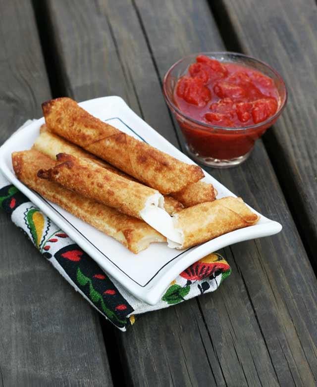 Repin to save! Homemade wonton wrapper mozzarella sticks recipe.