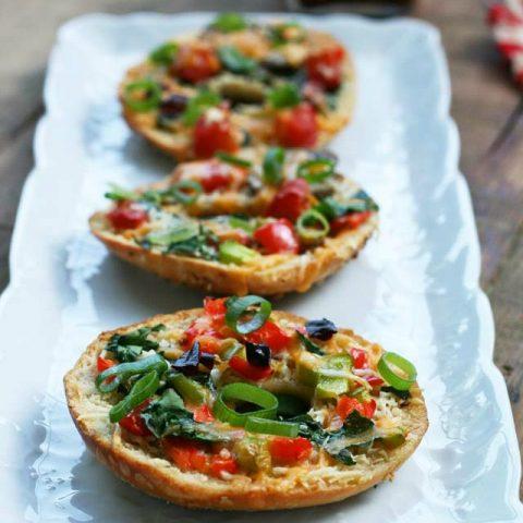 Thin crust bagel pizzas