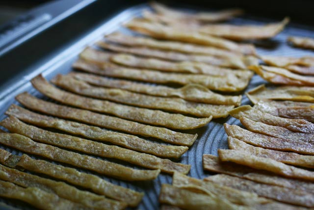Baked tortilla strips, as a soup topping, from Cheap Recipe Blog