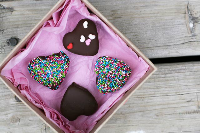 Make your own heart-shaped chocolate-covered marshmallows. Get the recipe!