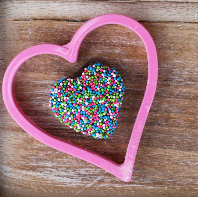 Chocolate-covered marshmallow heart with sprinkles.