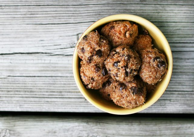 Paleo energy bites, made with almond butter, coconut, coconut oil, and other health ingredients.