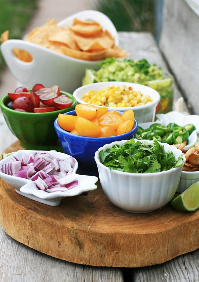 How to assemble a DIY guacamole bar: Add lots of delicious toppings to guacamole. Each party guest can make their own!
