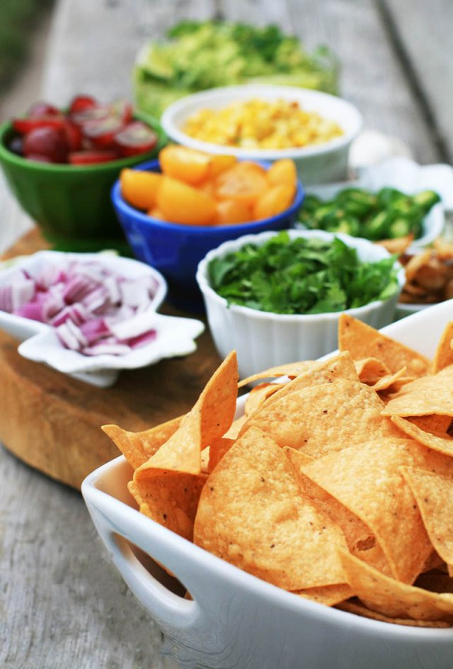 DIY Guacamole Bar: Give your party guests plain guacamole, and have them add a bunch of delicious ingredients to customize their dip!