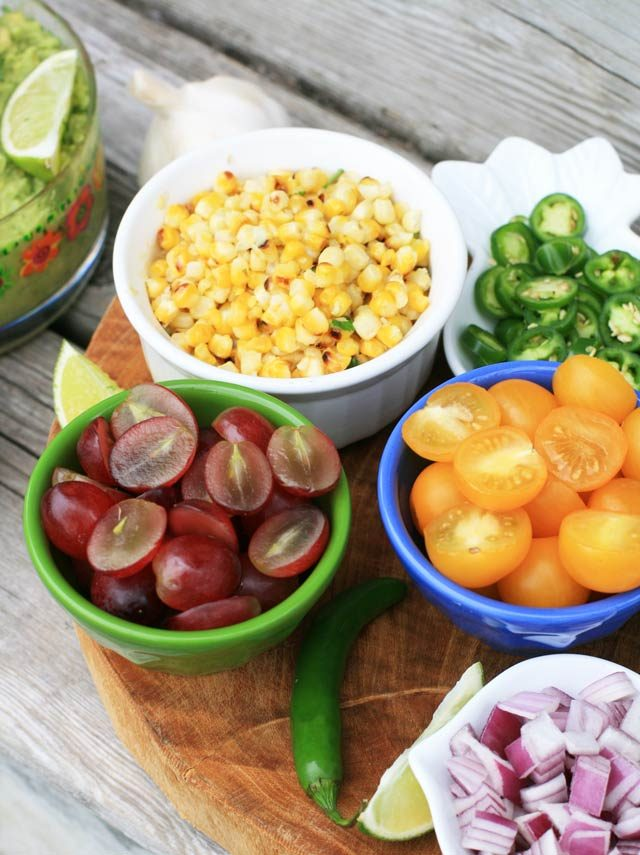 Toppings and mix-ins for a DIY guacamole bar. Click through for recipe!