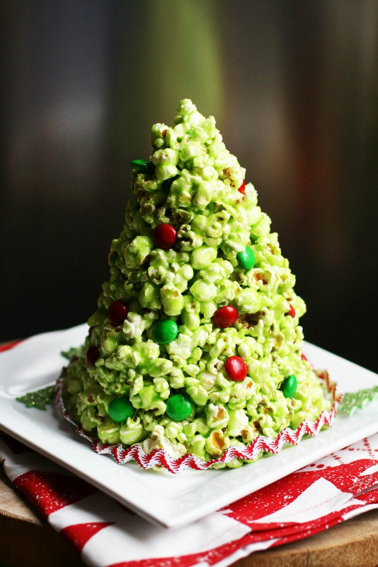 A popcorn Christmas tree is super easy to make, and such a festive holiday treat! Click through for recipe.