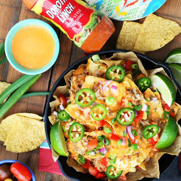 Game day pulled pork nachos: The perfect nachos to feed a crowd at a football watching party!