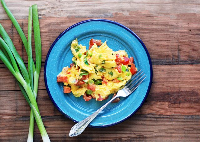 Learn how to make huevos pericos - Colombian scrambled eggs. Add roma tomato and green onions to add a fresh component to traditional scrambled eggs.
