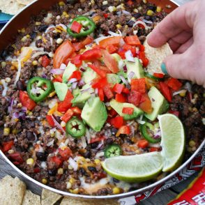 Dinner in 20 minutes! Check out this Mexican ground beef skillet, served with tortilla chips.