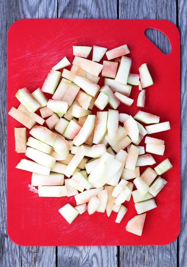 How to make watermelon pickles: Cut peeled watermelon rind into bite-sized pieces.