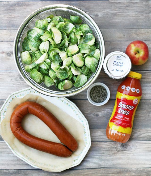 Ingredients to make maple-roasted Brussels sprouts and ring bologna.